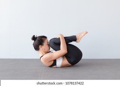Image result for pexel.com image of wind relieving pose yoga