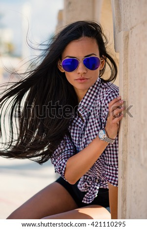 f7f0d38fb1 Beautiful young woman wearing sunglasses on the beach close up portrait.  Filtered image.
