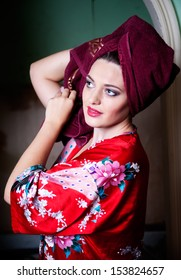 beautiful young woman wearing a towel and bathrobe at room background