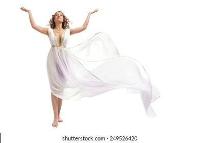 The Beautiful Young Woman Wearing White and Gold Greek Costume, Raising Her Arms on the White Background
