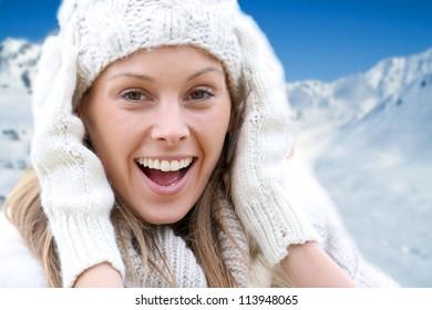 Beautiful young woman wearing woolen clothes