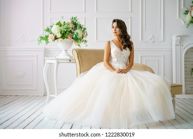 beautiful young woman in wedding dress beautiful makeup and hairstyle happy bride.