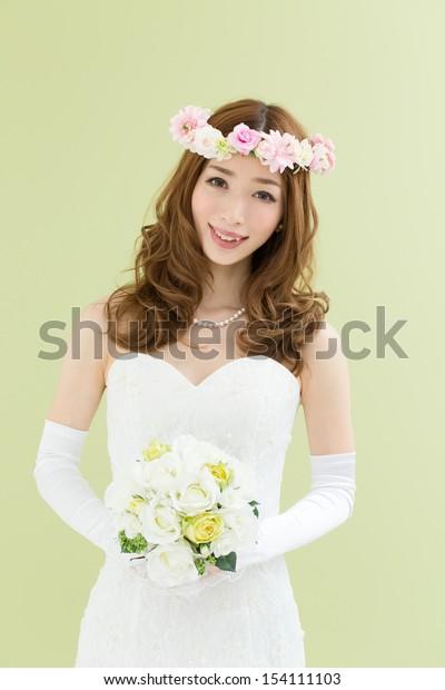 Beautiful young woman in a wedding dress