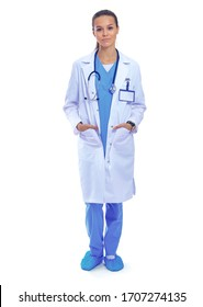 Beautiful young woman in white coat posing with hand in pocket. Woman doctor