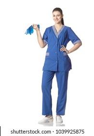 Beautiful young woman of white race in garment cleaning woman standing with blue rubber gloves, isolated on white background.