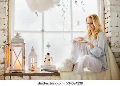 beautiful young woman in white room with Christmas decorations