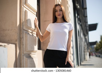 Beautiful young woman in white t-shirt on the street.