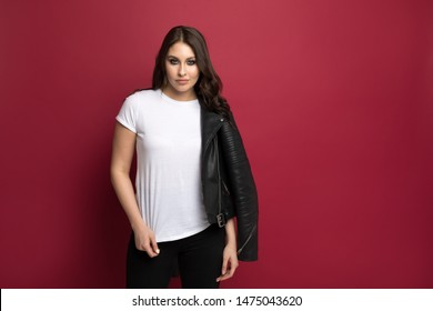 Beautiful young woman in a white t-shirt and jacket . Mock-up.