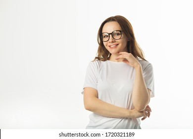 beautiful young woman in a white t-shirt on a white background