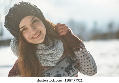 a Beautiful young woman in winter outside