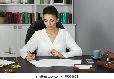 Beautiful young woman working in modern office