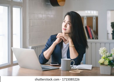 Beautiful young woman working on laptop computer at her home. Work from home and social distancing concept.