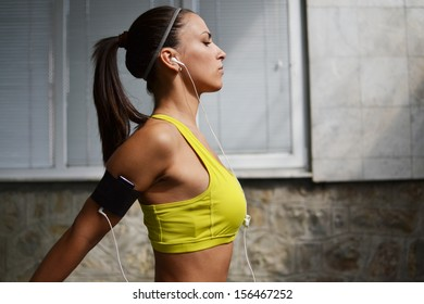 beautiful young woman working out in the fitness studio