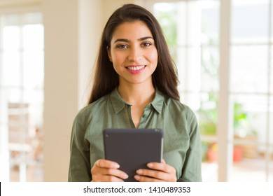 Beautiful young woman working using touchpad tablet