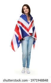 Beautiful young woman wrapped in british flag on white background