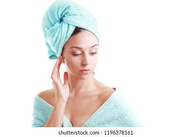 beautiful young woman wrapped in pastel colored towels