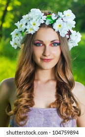 Beautiful Young Woman in a wreath with a flowers over face