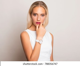 Beautiful young woman with wrist watch