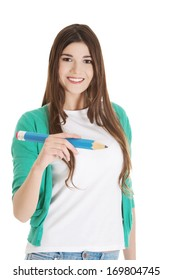 Beautiful young woman writing on copy space with pencil. Isolated on white.