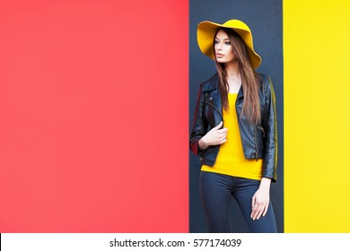 Beautiful young woman in yellow hat - Shutterstock ID 577174039