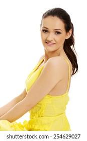 Beautiful young woman in yellow summer dress.