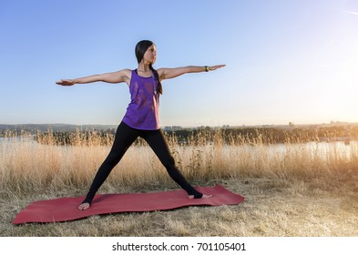 Beautiful young woman in yoga outfit, practicing yoga
