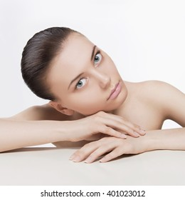 beautiful young woman.beauty brunette girl with clean face. Skin care cosmetics concept