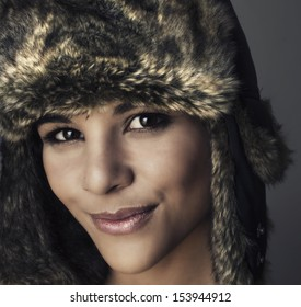 Beautiful young woman's face - wearing Russian style winter hat,