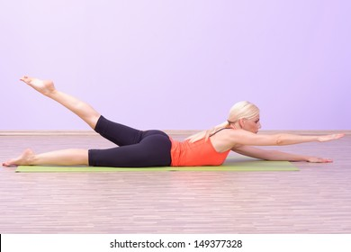 Beautiful young women doing Pilates exercise
