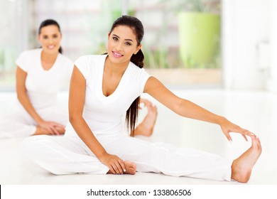 Beautiful young women doing stretching exercise