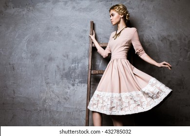 Beautiful young women in a formal embroidered dress
