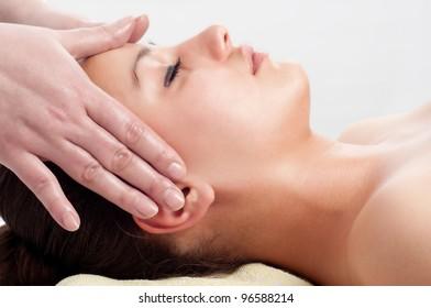 Beautiful young women getting a face massage.