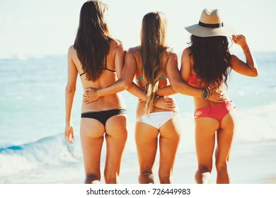 Beautiful young women having fun at the beach