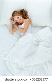 Beautiful young women lying on bed