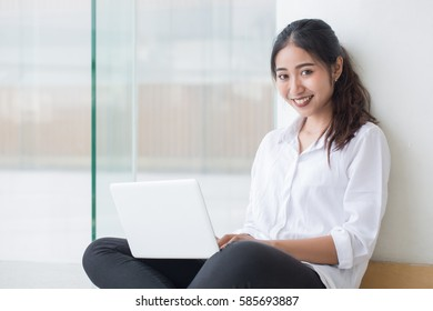 Beautiful young women with notebook tablet