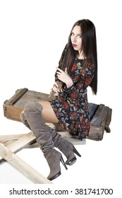 beautiful young women posing in studio with wooden case