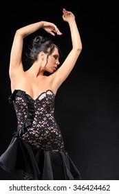 Beautiful young women wearing evening dress on black background