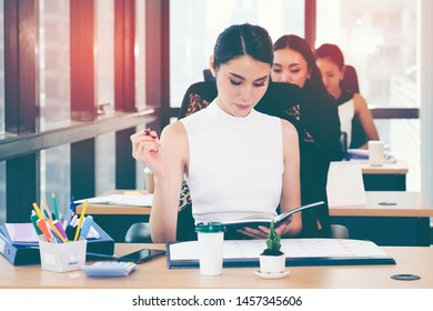 Beautiful young working women working in the office. Asian Business woman.