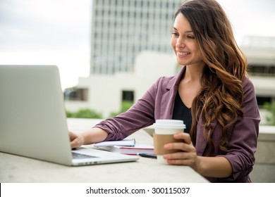 Beautiful young writer college student blogger journalist web internet computer with coffee