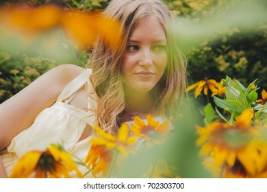beautiful younge girl in a garden at sunny day