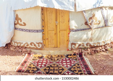 A beautiful yurt under a tent on a sunny day