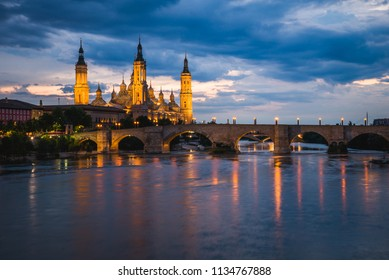 Beautiful Zaragosa Cathedral in the evening, Spain. Bridge viewpoint over the river Ebro
