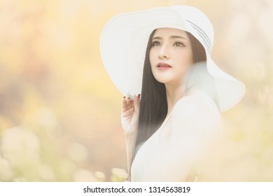 Beautifulhappy girl in vintage dress and hat standing near colorful  flowers.Beautiful romantic young woman ad662f3c5ba3
