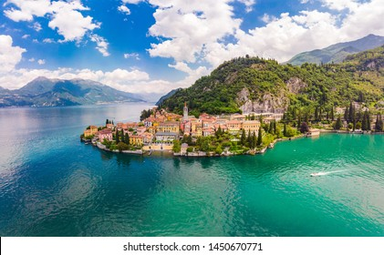 Beautifull aerial panoramic view from the drone to the Varenna - famous old Italy town on bank of Como lake. High top view to Water landscape with green hills, mountains and city in sunny summer day.