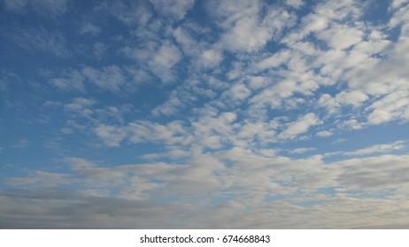 Beautifull blue sky with clouds.Niebo lekko zachmurzone. - Shutterstock ID 674668843