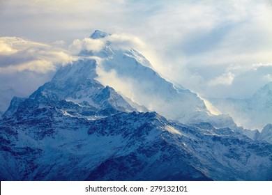 beautifull cloudy sunrise in the mountains with snow ridge. Trek around Annapurna mount. Himalaya, Nepal.