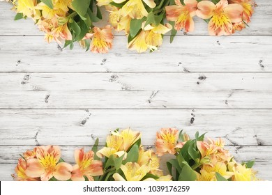 Beautifull flowers over wood planks background