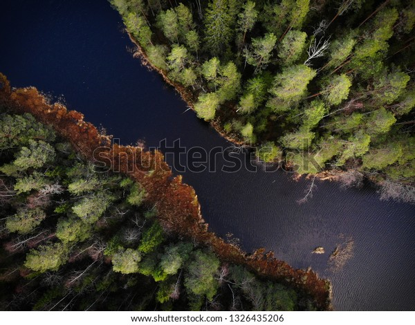 Beautifull small river crossing wilderness in Lapland, Finland. In these areas you can breathe the cleanest air in the world