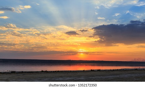 Beautifull sunset near the sea with evening sun and clowds