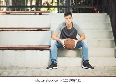 Beautifull teenage boy with basketball ball